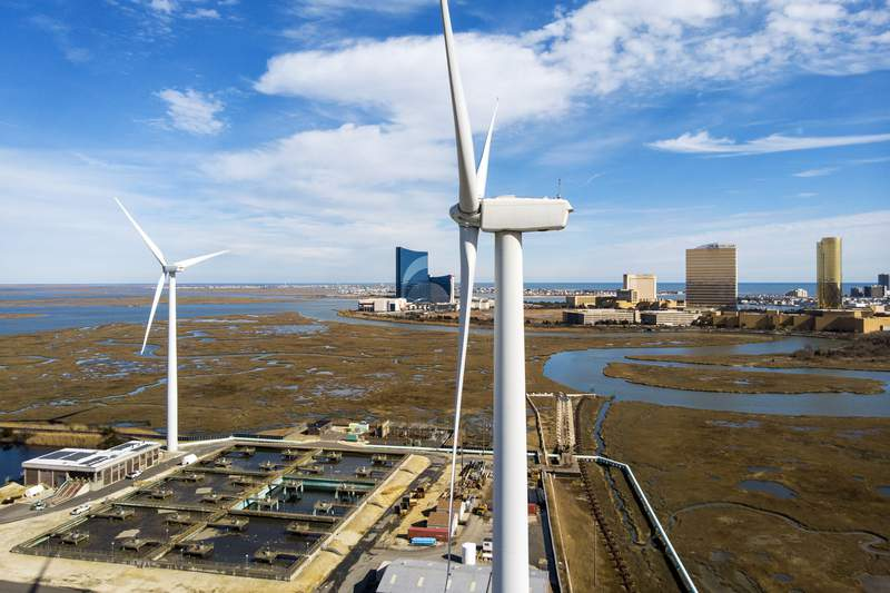 FILE - Wind turbines spin to generate electrical power in Atlantic City, N.J., on Wednesday, Feb. 17, 2021. A report released Tuesday, Oct. 12 by a group studying the economics of the offshore wind industry predicts that the industrys supply chain will be worth $109 billion over the next decade.  (AP Photo/Ted Shaffrey, File)