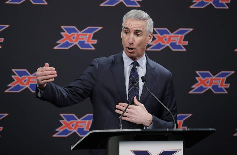 FILE - In this Feb. 25, 2019, file photo, XFL Commissioner Oliver Luck gestures during a press conference in Seattle.  When the XFL debuts in February, it will take a Star Trek approach of going where no football league has gone before. (AP Photo/Ted S. Warren, File)