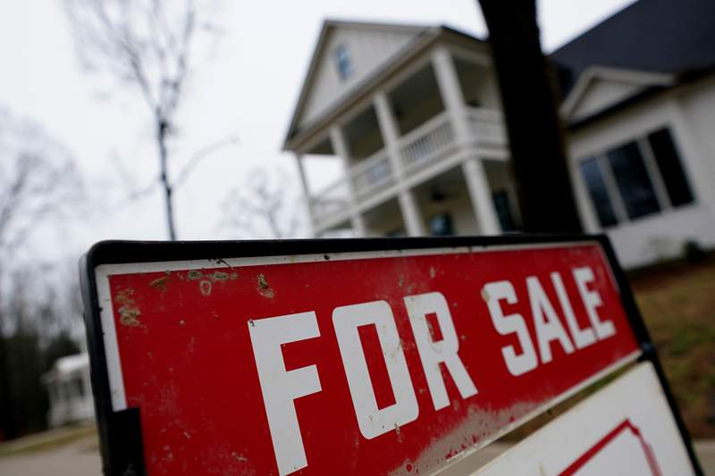 FILE - In this Thursday, Feb. 18, 2021 file photo, a new home is for sale in Madison, Ga. Mortgage rates fell for the third straight week, dipping below 3% for the first time in two months. Mortgage buyer Freddie Mac reported Thursday, April 22 that the benchmark 30-year home-loan rate declined to 2.97% this week from 3.04% last week. (AP Photo/John Bazemore, File)
