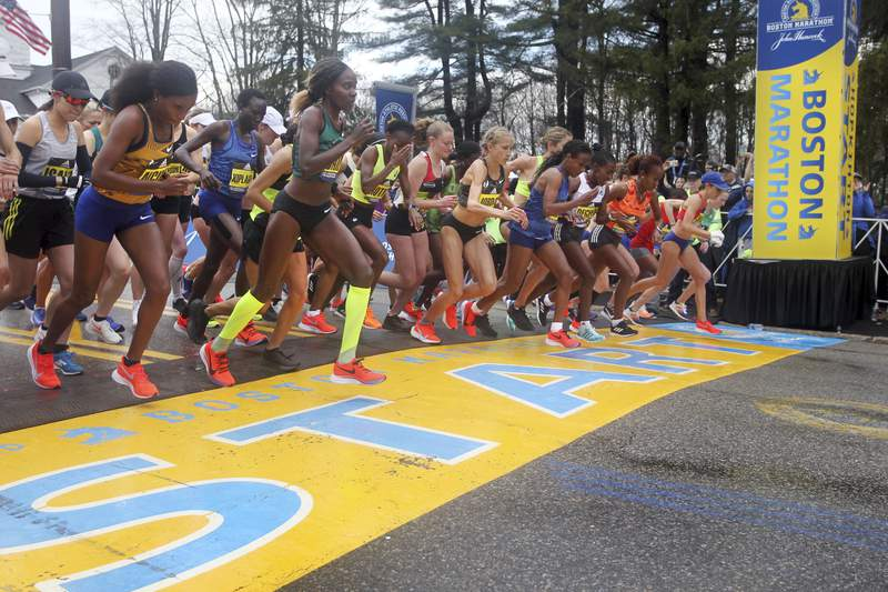 FILE - In this April 15, 2019, file photo, the elite women's division runners break from the start of the 123rd Boston Marathon in Hopkinton, Mass. Native Americans in Massachusetts are calling on the organizers of the Boston Marathon to move the already rescheduled date for the storied race on Oct. 11 because it conflicts with a day meant to commemorate the contributions of Indigenous peoples. (AP Photo/Stew Milne, File)