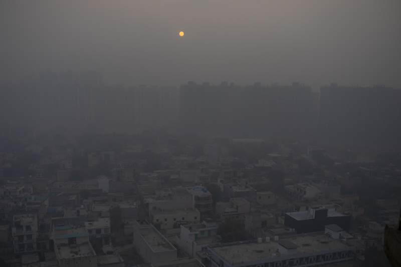 FILE - In this Saturday, Jan. 2, 2021 file photo, the morning sun is seen through a blanket of smog on the outskirts of New Delhi, India. A United Nations report released on Friday, Feb. 26, 2021, finds the countries of the world are not promising to do enough carbon-cutting to keep global warming from hitting dangerous levels. (AP Photo/Altaf Qadri)
