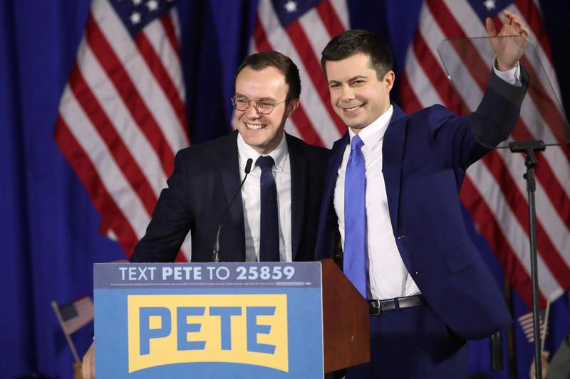 FILE - In this Feb. 11, 2020, file photo Democratic presidential candidate former South Bend, Ind., Mayor Pete Buttigieg acknowledges supported as he stands on stage with his husband Chasten Buttigieg at a primary night election rally in Nashua, N.H. Transportation Secretary Pete Buttigieg has announced that he and husband Chasten have become parents. Buttigieg, the first openly gay Cabinet secretary confirmed by the Senate, posted a photo of their two children on Saturday, Sept. 4, 2021, on his personal Twitter account. (AP Photo/Mary Altaffer, File)