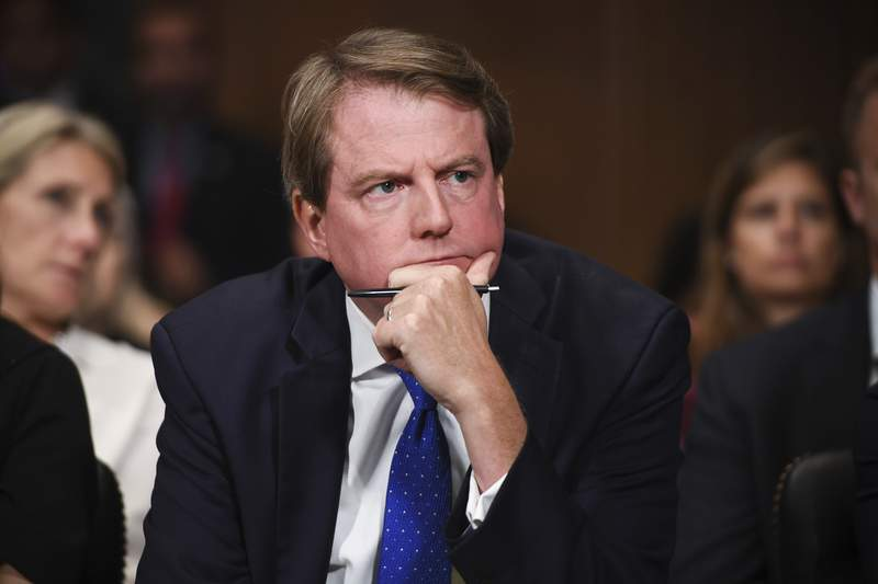 FILE - In this Sept. 27, 2018, file photo, then-White House counsel Don McGahn listens as Supreme court nominee Brett Kavanaugh testifies before the Senate Judiciary Committee on Capitol Hill in Washington. The federal appeals court in Washington, is giving the House another shot at forcing McGahn to appear before Congress. Nine of the Democratic-dominated courts 11 judges are hearing arguments by telephone Tuesday, April 28, 2020, in a dispute between House Democrats and President Donald Trumps administration over a subpoena for McGahns testimony that was issued a year ago by a House committee.  (Saul Loeb/Pool Photo via AP, File)