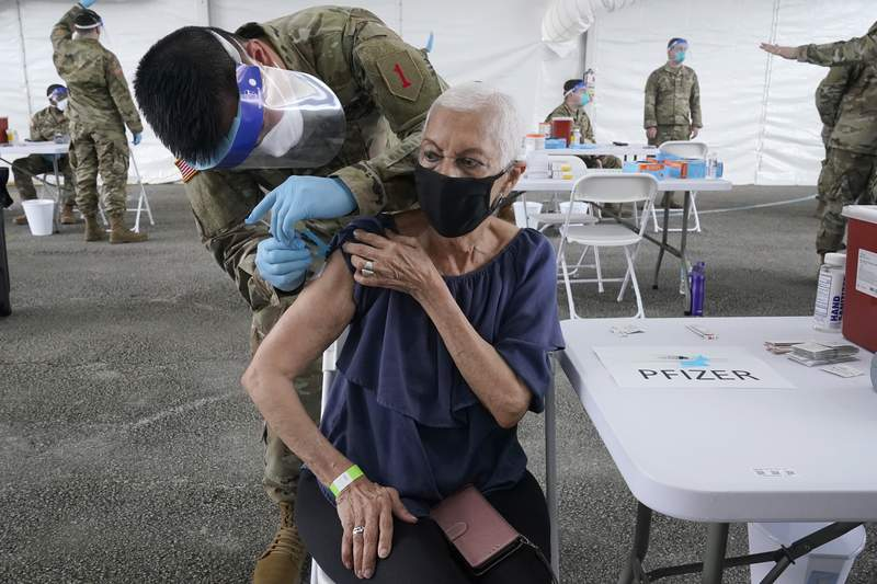 Ivonne Burgess, 81, gets the first dose of the Pfizer COVID-19 vaccine at a FEMA vaccination site at Miami-Dade College, Wednesday, March 3, 2021, in North Miami.