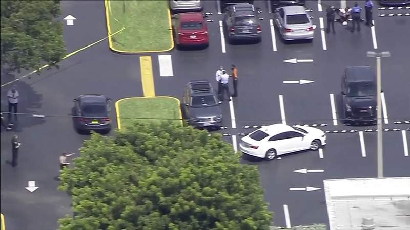 Sky 10 was over the scene of a parking lot shooting in Miami-Dade County on Thursday afternoon near FIU's main campus.