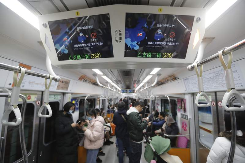 FILE - This Jan. 29, 2020, file photo shows screens warning about a new coronavirus in a subway train in Seoul, South Korea. The dangerous virus spreading through China threatens a wide range of industries with global ties to the worlds second largest economy. Chinese authorities have cut off access to Wuhan, where the virus originated, and 16 other cities to prevent further spread of the virus, affecting more than 50 million people. (AP Photo/Ahn Young-joon, File)