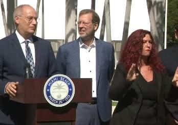 Mayor Dan Gelber, Mayor Daniella Levine Cava and members of the Aspen Insitute announce a partnership with an energy and environmental consortium.