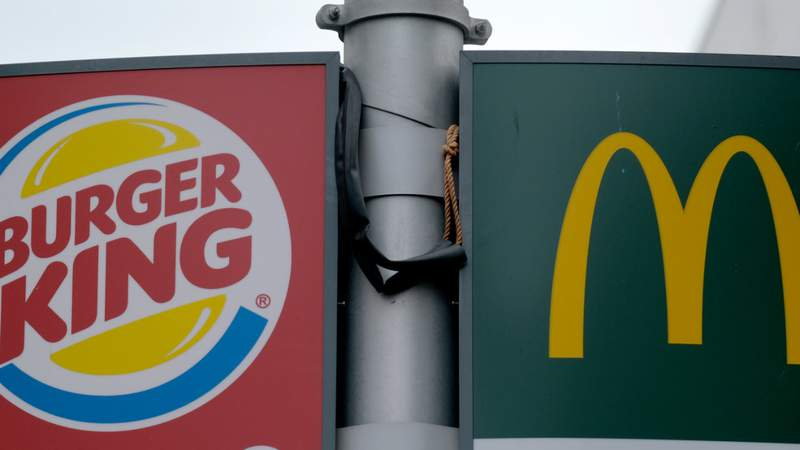 Signages of fast-food restaurants Burger King and McDonald's. Photo by Yuriko Nakao/