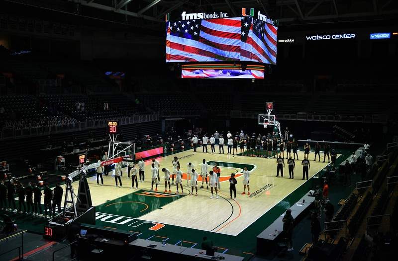The Miami Hurricanes and the Duke Blue Devils stand during the National Anthem prior to the game at Watsco Center on February 01, 2021 in Miami, Florida.