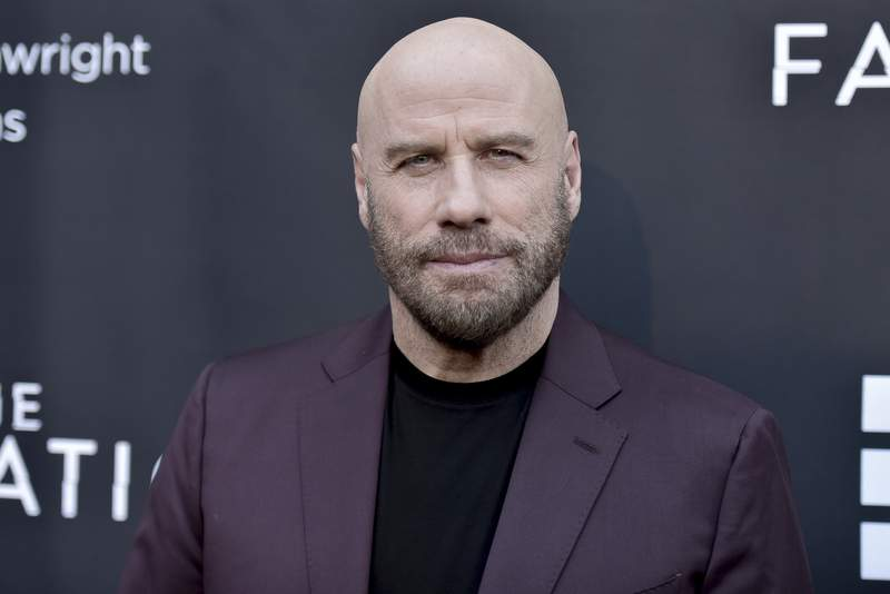 """FILE - In this Aug. 22, 2019 file photo, actor John Travolta attends the LA premiere of """"The Fanatic"""" at the Egyptian Theatre in Los Angeles. The Maine mansion that Travolta shared with his late wife, actor Kelly Preston, has been put up for sale. The 67-year-old star of Grease and Saturday Night Fever recently listed the home on Islesboro, an island off the coast of Maine, for $5 million, according to the Portland Press Herald.  (Photo by Richard Shotwell/Invision/AP, File)"""