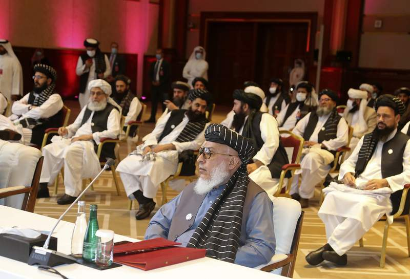 FILE - In this Sept. 12, 2020, file photo, Taliban negotiator Abbas Stanikzai, center front, and his delegation attend the opening session of peace talks between the Afghan government and the Taliban, in Doha, Qatar. Afghanistans Taliban on Thursday, Oct. 8, 2020, welcomed a tweet from President Donald Trump in which he promised to have the last of the U.S.'s troops out of Afghanistan by Christmas. If that withdrawal happens, it would be months ahead of schedule and the tweet made no reference to a Taliban promise to fight terrorist groups  a previous pre-requisite for an American withdrawal. (AP Photo/Hussein Sayed, File)