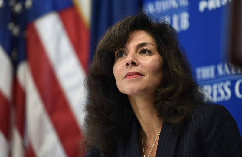 FILE - In this Sept. 21, 2018, file photo, A. Ashley Tabaddor, a federal immigration judge in Los Angeles is introduced to speak at the National Press Club in Washington. From 2017 to 2021, she was president of the National Association of Immigration Judges.   The U.S. Justice Department has dropped its opposition to reviving a union for immigration judges that had been stripped of authority during the final months of the Trump administration. The judges' union said in a statement Tuesday, June 29, 2021, that it was optimistic the move would lead to restoration of collecting bargaining rights and reverse what it said was an attempt by the Trump administration to silence judges. (AP Photo/Susan Walsh, File)