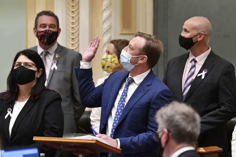 Queensland state Deputy Premier Steven Miles, center, waves to the public gallery after the vote for the Voluntary Assisted Dying bill at Queensland Parliament in Brisbane, Australia, Thursday, Sept. 16, 2021. Voluntary euthanasia became legal in a fifth Australian state more than 20 years after the country repealed the world's first mercy-killing law for the terminally ill. (Darren England/AAP Image via AP)