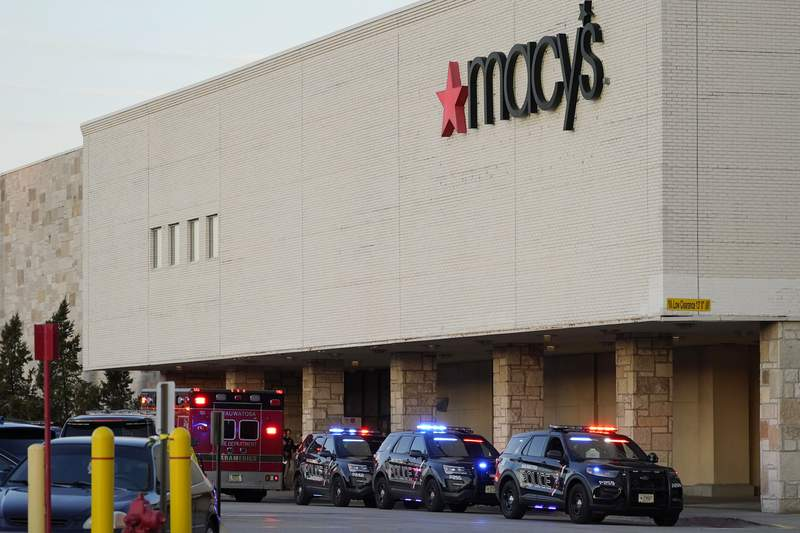Police investigate a shooting at the Mayfair Mall, Friday, Nov. 20, 2020, in Wauwatosa, Wis. Multiple people were shot Friday afternoon at the mall. On Saturday, police arrested at 15-year-old suspected in the shooting. (AP Photo/Nam Y. Huh)