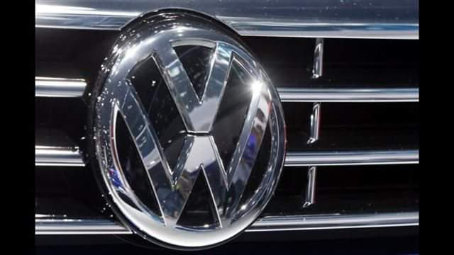 FILE - In this Sept. 22, 2015, file photo, the logo of Volkswagen at a car is photographed during the Car Show in Frankfurt, Germany.  VW has until Friday, Nov. 20, 2015  to submit a draft plan to fix four-cylinder diesels to the U.S....
