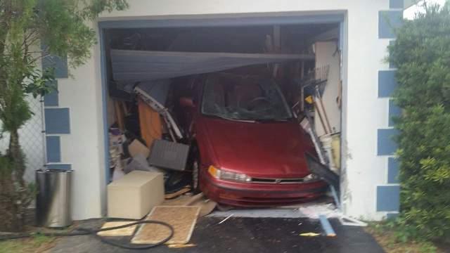 A car crashed through the garage door of a Lauderhill house.