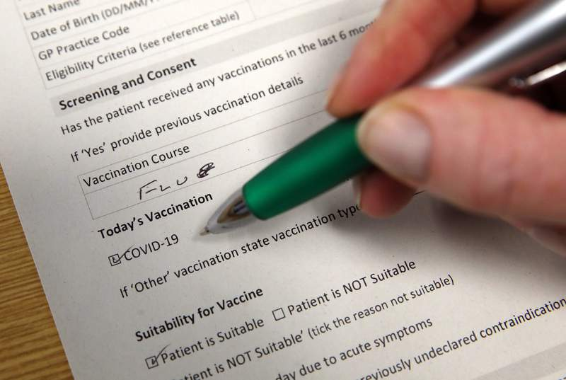A consent form is filled out for the Pfizer/BioNTech Covid-19 vaccine. (Photo by Andrew Milligan - Pool / Getty Images)