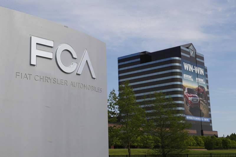 """FILE - This May 27, 2019, file photo shows the Fiat Chrysler Automobiles world headquarters in Auburn Hills, Mich.Fiat Chrysler Automobiles is denying allegations by General Motors that FCA used foreign bank accounts to bribe union officials so they would stick GM with higher labor costs. In court papers filed Monday, Aug. 10, 2020, the Italian-American automaker said GM was using court records to make defamatory and baseless"""" claims.  (AP Photo/Paul Sancya, File)"""
