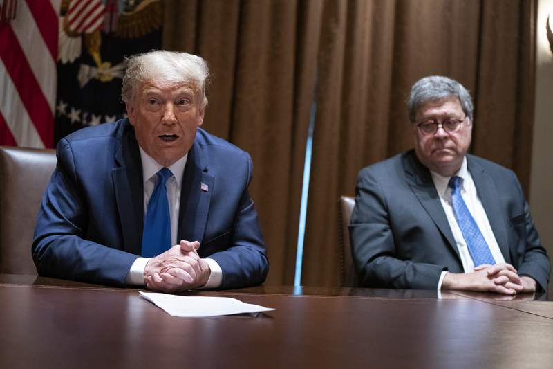 FILE - In this Sept. 23, 2020, file photo Attorney General William Barr listens as President Donald Trump speaks during a meeting with Republican state attorneys general in the Cabinet Room of the White House in Washington. The relationship between President Donald Trump and top ally Attorney General William Barr is fraying over the lack of splashy indictments so far in the Justice Departments investigation into the origins of the Russia probe, according to people familiar with the matter. (AP Photo/Evan Vucci, File)