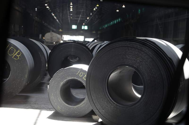 FILE - In this June 28, 2018, file photo, rolls of finished steel are seen at the U.S. Steel Granite City Works facility in Granite City, Ill.  Companies seeking relief from President Donald Trumps taxes on imported steel and aluminum ran into long delays and cumbersome paperwork, a federal watchdog found, Wednesday, Sept. 16, 2020. The U.S. Government Accountability Office reported that the Commerce Department, overwhelmed by companies lobbying to avoid the tariffs, could not meet its own deadline for processing around three-fourths of the requests. (AP Photo/Jeff Roberson, File)