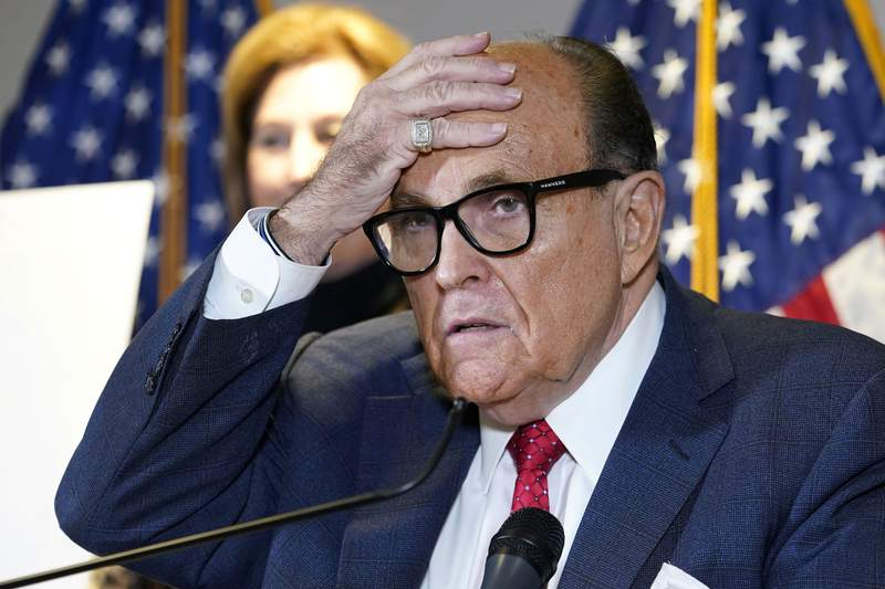 FILE - In this Nov. 19, 2020, file photo, former New York Mayor Rudy Giuliani, a lawyer for then-President Donald Trump, speaks during a news conference at the Republican National Committee headquarters in Washington. (AP Photo/Jacquelyn Martin, File)