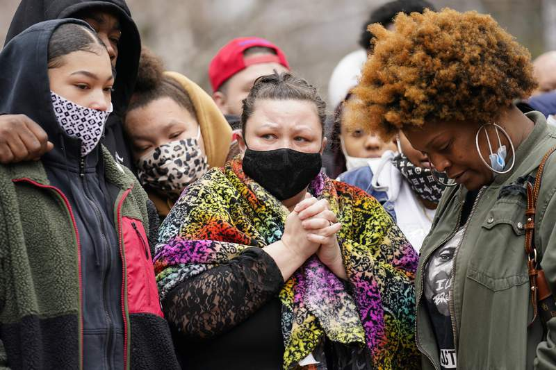 Katie Wright, center, mother of Daunte Wright, arrives to speak during a news conference, Tuesday, April 13, 2021, in Minneapolis. Daunte Wright, 20, was shot and killed by police Sunday after a traffic stop in Brooklyn Center, Minn. (AP Photo/John Minchillo)