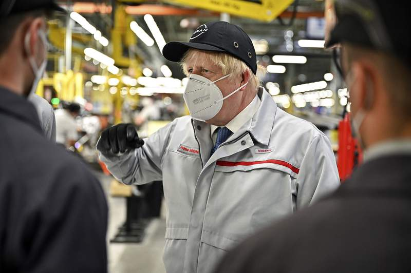 Britain's Prime Minister Boris Johnson during his visit to Nissan plant in Sunderland, England, Thursday July 1, 2021. Johnson said unspecified extra precautions will be needed in coming weeks even as he voiced confidence Thursday that the remaining restrictions on social contact in England will be lifted on July 19. During a visit to the Nissan car plant in the north England city of Sunderland, Johnson said he is planning to reveal details of what the end of lockdown restrictions will look like in the coming days. (Jeff J Mitchell/Pool Photo via AP)