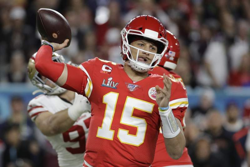 FILE - In this Feb. 2, 2020, file photo, Kansas City Chiefs quarterback Patrick Mahomes (15) passes against the San Francisco 49ers during the first half of the NFL Super Bowl 54 football game in Miami Gardens, Fla. The Chiefs made sure they will have Super Bowl MVP Mahomes around as long as possible. Mahomes agreed to a 10-year extension worth $503 million, according to his agency, Steinberg Sports. The deal is worth $477 million in guarantee mechanisms and includes a no-trade clause and opt-out clauses if guarantee mechanisms are not met. It is the richest contract in professional sports history, surpassing Mike Trouts $426.5 million deal with the Los Angeles Angels. (AP Photo/Patrick Semansky, File)