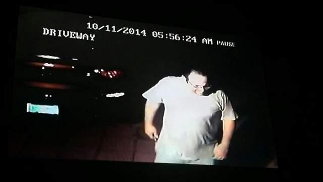 Surveillance image of burglar taken from driveway of neighbor's home