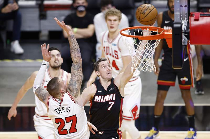 Goran Dragic of the Miami Heat goes up for a layup against Daniel Theis of the Chicago Bulls during the second quarter at American Airlines Arena on April 26, 2021 in Miami, Florida.