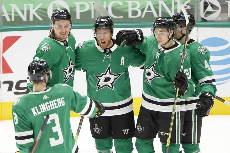 Joe Pavelski of the Dallas Stars celebrates with Roope Hintz of the Dallas Stars, Jason Robertson of the Dallas Stars, Miro Heiskanen of the Dallas Stars and John Klingberg of the Dallas Stars after scoring a goal against the Tampa Bay Lightning at American Airlines Center on March 25, 2021 in Dallas, Texas.