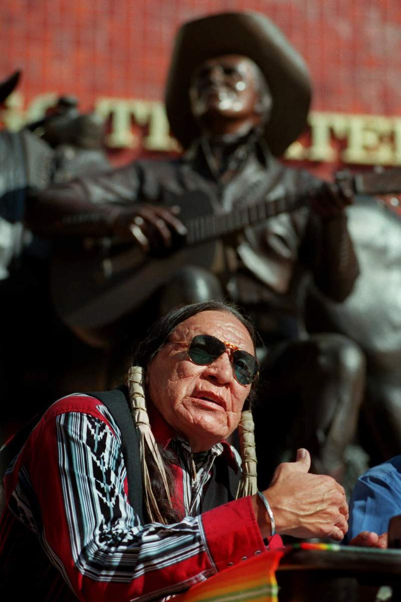 FILE - In this Feb. 18, 2000 file photo, Saginaw Grant, veteran actor and writer, responds to a question during a news confernce, at the Gene Autry Museum in Los Angeles. Grant, a prolific Native American character actor and hereditary chief of the Sac & Fox Nation of Oklahoma, has died. He was 85. Grant's publicist, Lani Carmichael, says Grant died peacefully in his sleep of natural causes on Wednesday, July 28, 2021, at a private-care facility in Hollywood, California. (AP Photo/E.J. Flynn File)