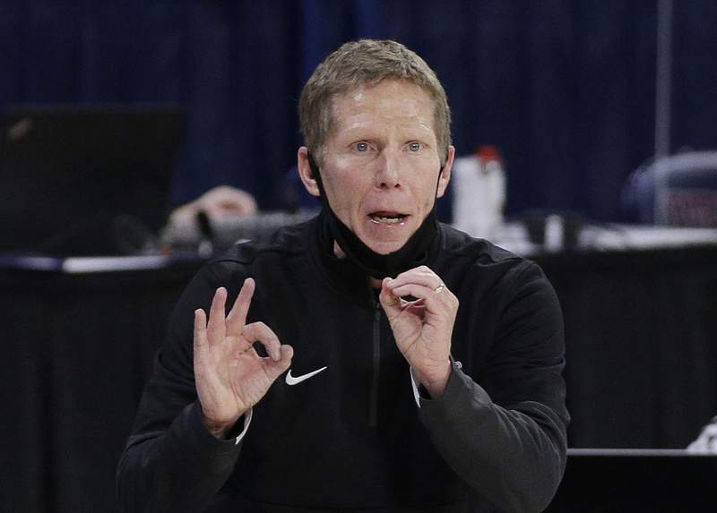 FILE - In this Feb. 25, 2021, file photo, Gonzaga coach Mark Few signals to players during the second half of an NCAA college basketball game against Santa Clara in Spokane, Wash. Few has been cited for driving under the influence. The Coeur dAlene Press and Spokesman-Review acquired a police report through a public information request that says Few was stopped Monday evening, Sept. 6, after he was called in as driving erratic and speeding. (AP Photo/Young Kwak, File)