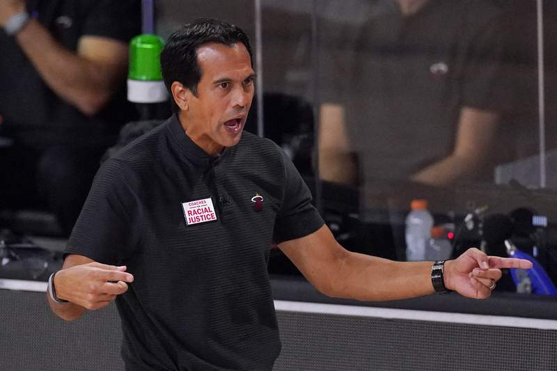 Miami Heat coach Erik Spoelstra directs his team during the first half against the Boston Celtics on Sunday.