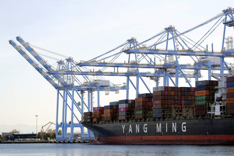 FILE - In this Nov. 4, 2019, file photo, cargo cranes are used to take containers off of a Yang Ming Marine Transport Corporation boat at the Port of Tacoma in Tacoma, Wash. The U.S. trade deficit rose in August to the highest level in 14 years. The Commerce Department reported Tuesday that the gap between the goods and services the United States sells and what it buys abroad climbed 5.9% in August to $67.1 billion.(AP Photo/Ted S. Warren, File)