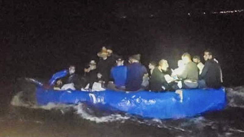 16 migrants sit together on board homemade raft.