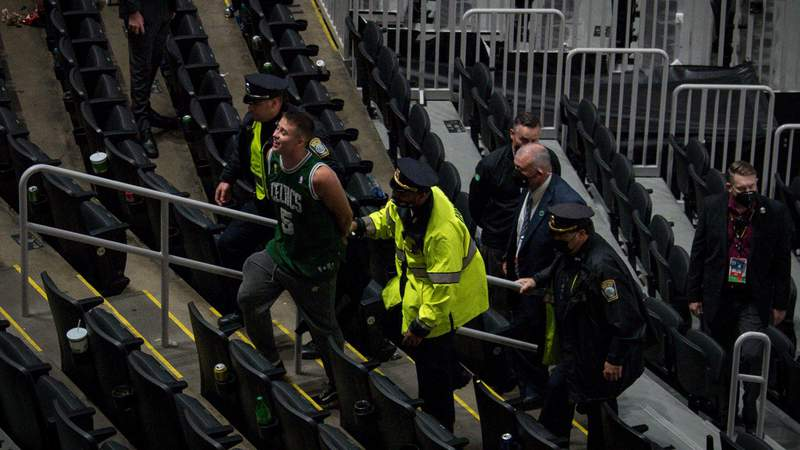 A fan is arrested after throwing a water bottle at Kyrie Irving #11 of the Brooklyn Nets after Game Four of the Eastern Conference first round series. Photo by Maddie Malhotra