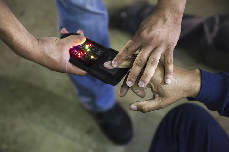 This undated photo obtained from Immigration and Customs Enforcement (ICE) shows a NeoScan 45 fingerprint scanner. The device, paired with an app known as EDDIE, is used by ICE to run remote ID checks. The app has been a core tool in President Donald Trumps deportation crackdown, according to a new report based on a Freedom of Information Act lawsuit. (Immigration and Customs Enforcement via AP)