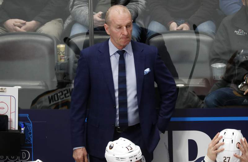 FILE - Buffalo Sabres head coach Ralph Krueger looks on in the first period of an NHL hockey game against the Colorado Avalanche Wednesday, Feb. 26, 2020, in Denver. Krueger marked his return to practice Sunday, feb. 14, 2021 with an upbeat but cautionary message following a 10-day bout with what he called moderately severe symptoms of COVID-19. (AP Photo/David Zalubowski, file)