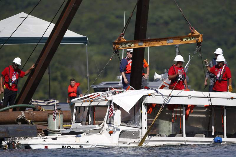 FILE - In this July 23, 2018, file photo, a duck boat that sank in Table Rock Lake in Branson, Mo., is raised after it went down the evening of July 19 after a thunderstorm generated near-hurricane strength winds. The National Transportation Safety Board will hold a virtual meeting Tuesday, April 27, 2020, to announce the results of an investigation into the tragedy that killed 17 of the 31 people on board. (Nathan Papes/The Springfield News-Leader via AP, File)