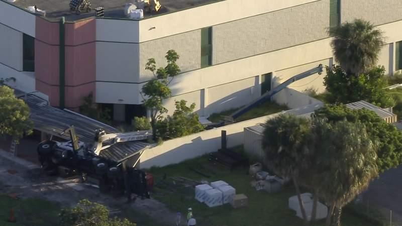 Sky 10 over scene of crane that collapsed behind Pompano Beach school.