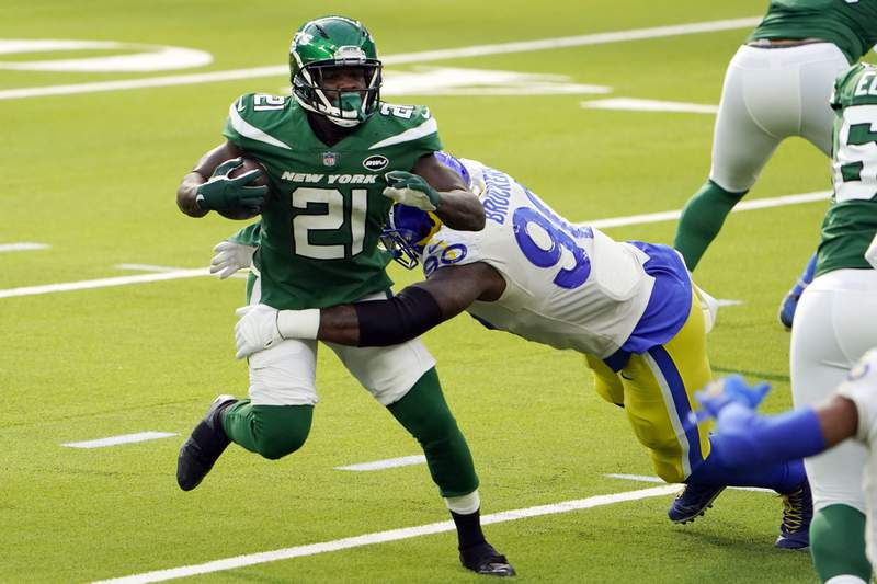 New York Jets running back Frank Gore (21) is tackled by Los Angeles Rams defensive end Michael Brockers (90) during the first half of an NFL football game Sunday, Dec. 20, 2020, in Inglewood, Calif. (AP Photo/Jae C. Hong)
