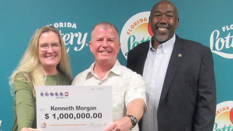 Kenneth Morgan, center, found a $1 million winning Powerball ticket on July 4.