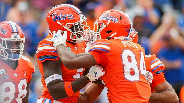 Keon Zipperer #9 of the Florida Gators celebrates a touchdown with Kyle Pitts #84 and teammates during the fourth quarter of a game against Towson.(Photo by James Gilbert/Getty Images)