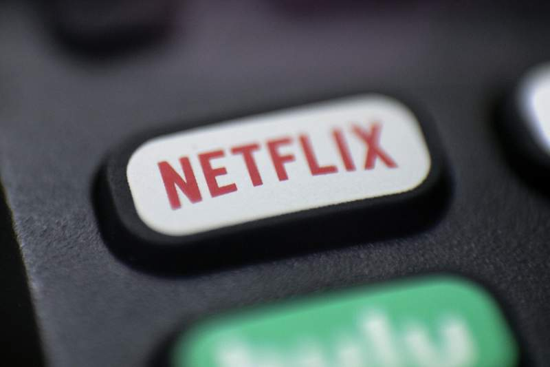 FILE - This Aug. 13, 2020 file photo shows a logo for Netflix on a remote control in Portland, Ore. Netflix is raising most of its U.S. prices by 8% to 13% as its video streaming service rides a wave of rising popularity spurred by government-imposed lockdowns that corralled people at home during the fight against the pandemic.  (AP Photo/Jenny Kane, File)