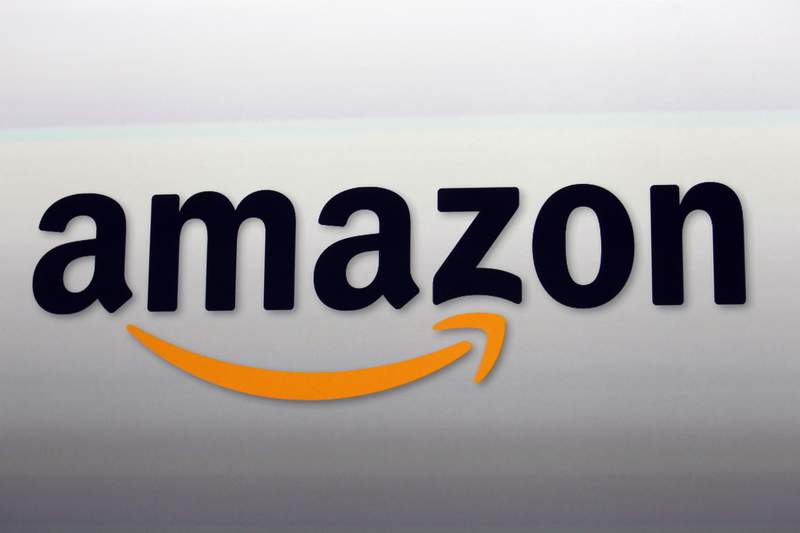 FILE - This Sept. 6, 2012, file photo, shows the Amazon logo in Santa Monica, Calif.  Amazon said Friday, June 26, 2020,  that it is buying self-driving technology company Zoox, which envisions a future where people will request a ride on their phones and a car will drive up without a driver.  (AP Photo/Reed Saxon, File)