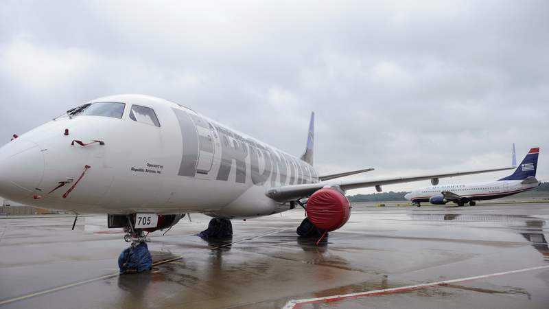 A Frontier Airlines plane sits on the tarmac.