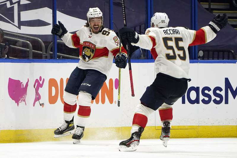 Florida Panthers left wing Ryan Lomberg celebrates after scoring against the Tampa Bay Lightning with center Noel Acciari during overtime in Game 3 of an NHL hockey Stanley Cup first-round playoff series Thursday, May 20, 2021, in Tampa, Fla.