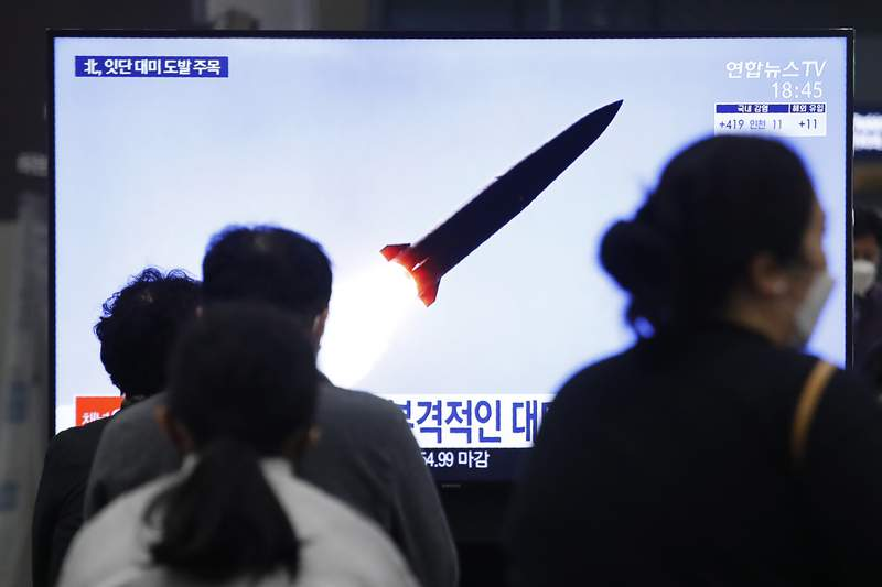 People watch a TV showing a file image of North Korea's missile launch during a news program at the Suseo Railway Station in Seoul, South Korea, Thursday. March 25, 2021. North Korea on Thursday test-fired its first ballistic missiles since President Joe Biden took office, as it expands its military capabilities and increases pressure on Washington while nuclear negotiations remain stalled. (AP Photo/Ahn Young-joon)