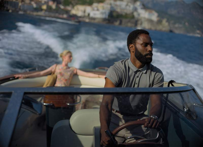 """This image released by Warner Bros. Entertainment shows Elizabeth Debicki, left, and John David Washington in a scene from """"Tenet."""" Some U.S. moviegoers will be able to see Christopher Nolans Tenet a few days early. Warner Bros. on Tuesday said that it would be offering early access screenings starting Aug. 31 as a gesture of support to the domestic theaters that are reopening after five months of being closed because of COVID-19. (Melinda Sue Gordon/Warner Bros. Entertainment via AP)"""